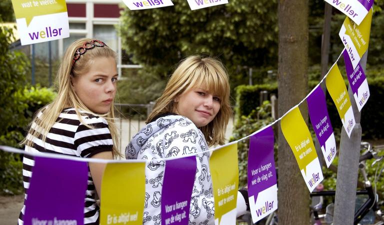tieners tijdens straatspeeldag Heerlerbaan